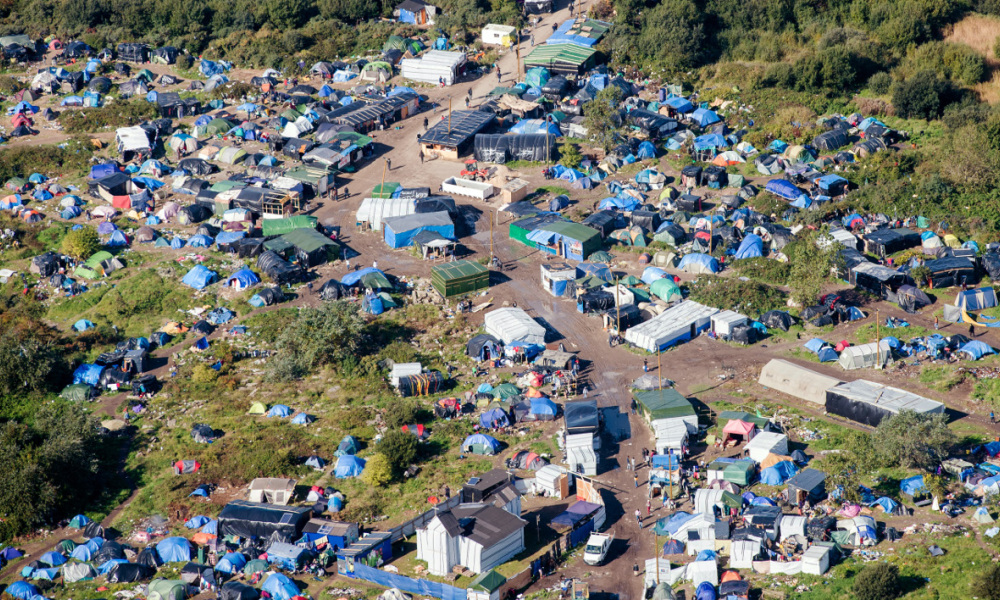 "An aerial picture taken on October 8, 2015 shows the ""New Jungle"" migrants camp where some 3,500 people live while they attempt to enter Britain, near the port of Calais, northern France."