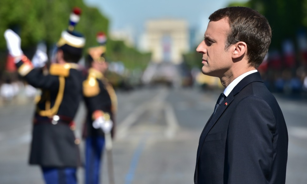 French President Emmanuel Macron attends the annual Bastille Day military parade on the Champs-Elysees avenue in Paris on July 14, 2017. The parade on Paris's Champs-Elysees will commemorate the centenary of the US entering WWI and will feature horses, helicopters, planes and troops. CHRISTOPHE ARCHAMBAULT / POOL / AFP
