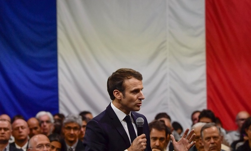 """French President Emmanuel Macron gestures as he speaks during a meeeting as part of the """"Great National Debate"""" on March 7, 2019, in Greoux-les-Bains, southeastern France."""