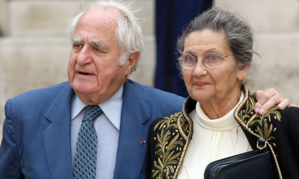 French historian, lawyer and immortal Simone Veil (R) leaves with her husband Antoine Veil
