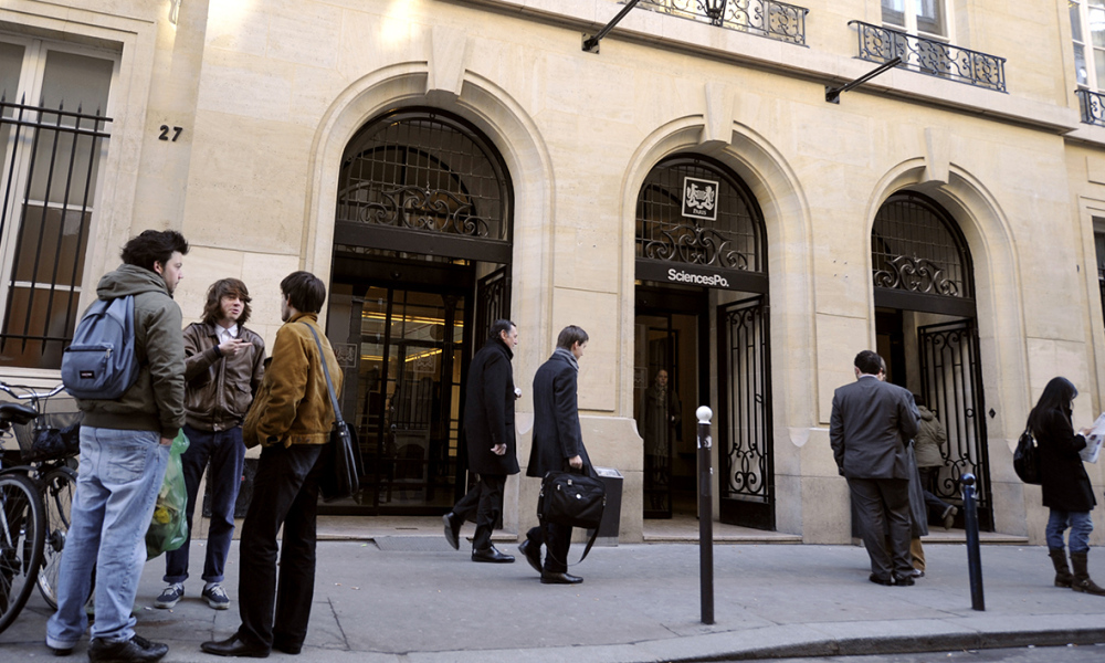 People stand on January 15, 2009 in Paris at the entrance of the Paris Institute of Political Studies (Sciences-Po). The president of the institute, Richard Descoings was named on January 12, 2009 in charge of a mission to reform French high school system