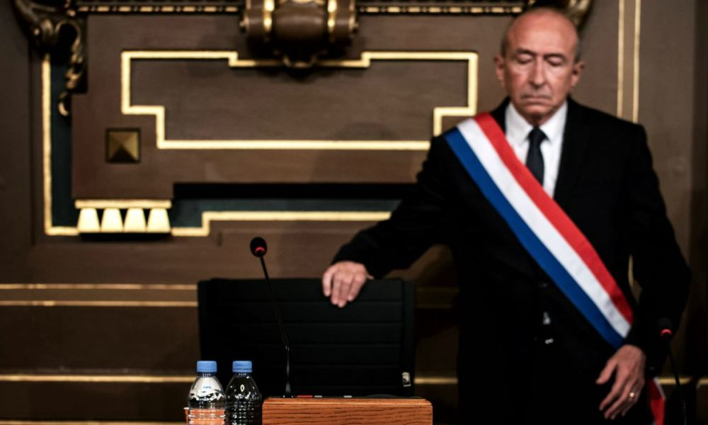 rench former interior minister Gerard Collomb is seen after being elected as the new mayor of Lyon on November 5, 2018 at Lyon city hall, following an extraordinary municipal council.  JEFF PACHOUD / AFP
