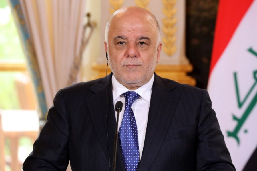"""(FILES) This file photo taken on October 05, 2017 shows Iraqi Prime Minister Haider al-Abadi giving a press conference in Paris. Abadi announced on December 9, 2017, """"the end of the war"""" in Iraq against the Islamic State group and that his forces had regained full control of the border with Syria."""
