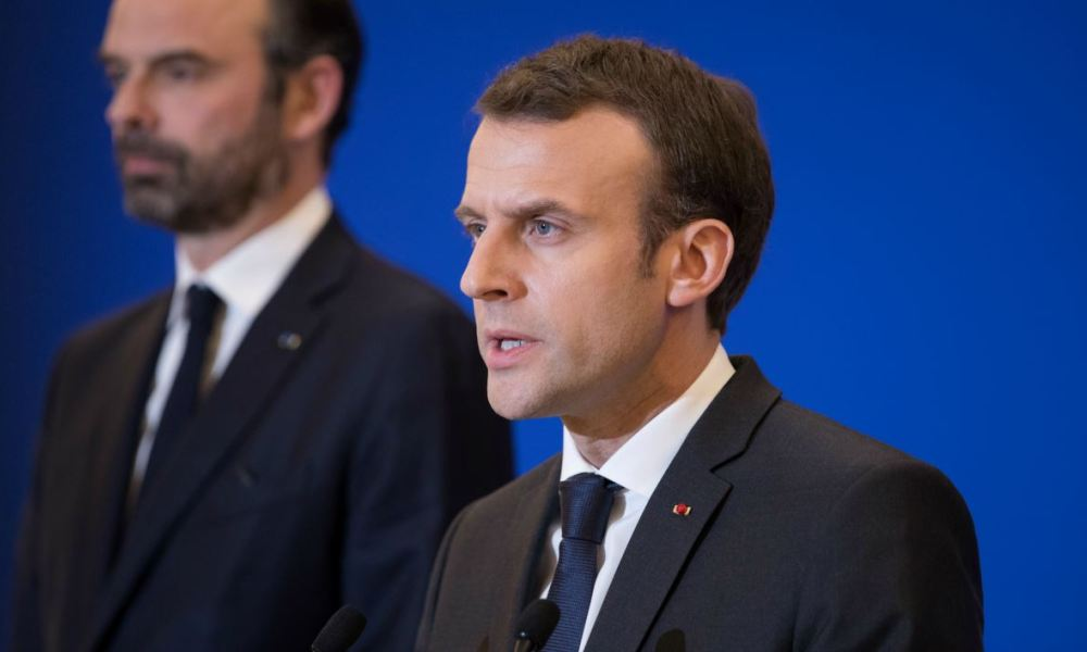 French President Emmanuel Macron delivers a speech at the Interior Minister in Paris attended by Prime Minister Edouard Philippe after a hostage situation in a supermarket in the village of Trebes, on March 23, 2018.  PHILIPPE WOJAZER / AFP / POOL