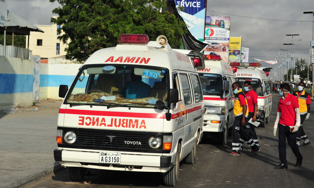 Somali ambulances carrying severely injured patients from the latest explosion in Mogadishu await to access the airport where the wounded will be evacuated on Turkish military planes on October 16, 2017. MOHAMED ABDIWAHAB / AFP