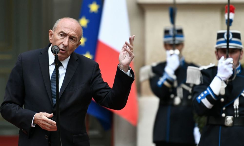 French Interior Minister Gerard Collomb gestures as he speaks at The Hotel de Beauvau - Interior Ministry - in Paris on October 3, 2018, during a speech after his resignation.  STEPHANE DE SAKUTIN / AFP