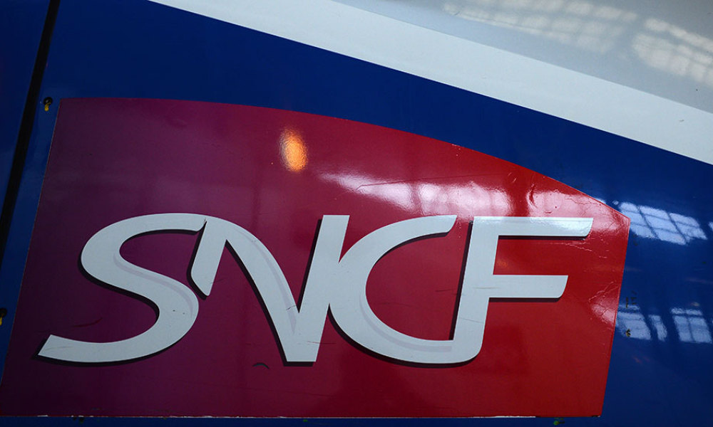 The logo of French national state-owned railway company SNCF is seen on a TGV high-speed train at the 'Technicentre Le Landy' in Saint-Denis, north of Paris, on April 12, 2016.