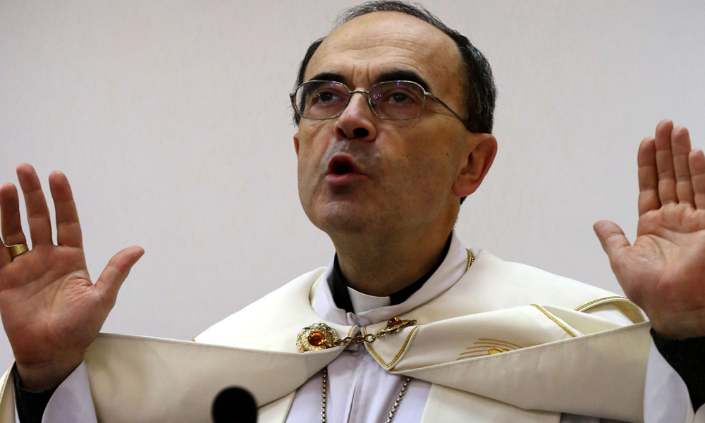 The Archbishop of Lyon Monseigneur Philippe Barbarin celebrates mass at Saint Marilia church in Arbil, attended by Iraqis who fled the violence in the northern city of Mosul after Islamic State group militants took control of the area, in the capital of the autonomous Kurdish region of northern Iraq, on December 6, 2014