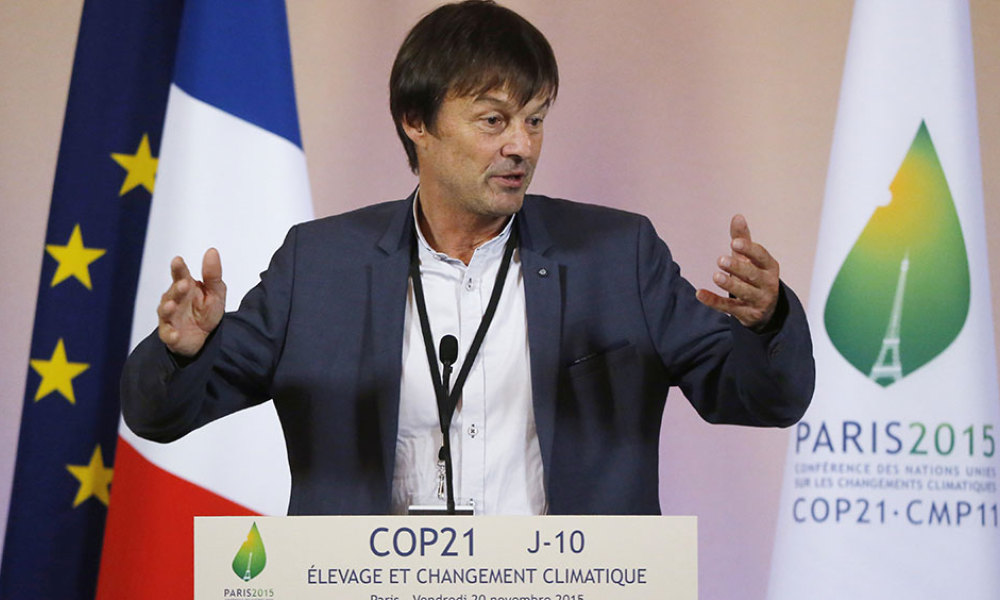 French environmental activist Nicolas Hulot gestures as he speaks to French farmers during a press conference on climate change at the Elysee Palace in Paris on November 20, 2015.