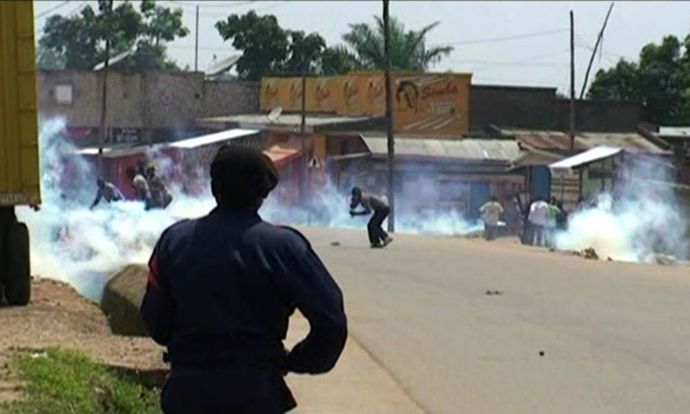 An image grab taken from AFPTV on August 18, 2017 shows police trying to contain a protest on August 17, 2016 in the town of Beni, in the eastern Democratic Republic of Congo (DRC). Three people, including a policeman, were killed on August 17, 2016 in clashes in the town in eastern DRC after a massacre sparked angry accusations of security failures by the government, local officials said. Several hundred people rallied on the main street of Beni at the end of a three-day mourning period called by civil groups over the murder of dozens of people during the evening of August 13. At least 50 people were hacked to death, the UN military mission to DRC said Wednesday, in the latest in a two-year string of attacks blamed on rebels. dsk Charly Kasereka / AFPTV / AFP