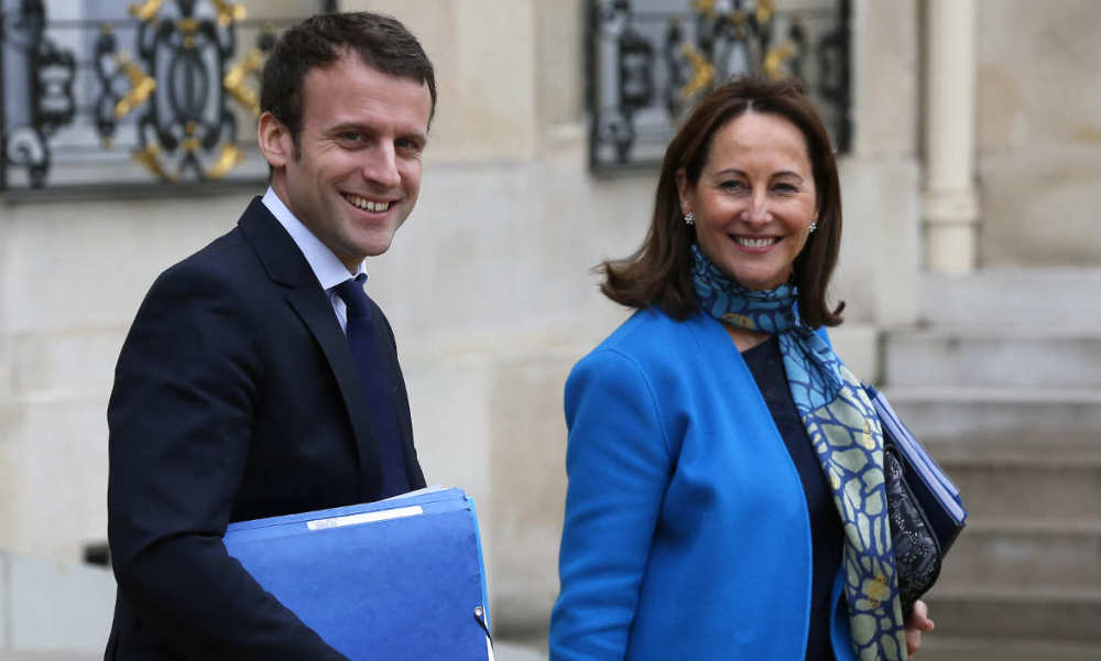 French Ecology Minister Ségolène Royal (R) and French Economy and Industry minister Emmanuel Macron leave the Elysee palace following the weekly Cabinet meeting on March 30, 2016 in Paris. AFP PHOTO / THOMAS SAMSON