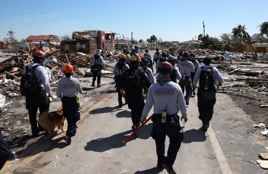 MEXICO BEACH, FL - OCTOBER 11: Members of the South Florida Search and Rescue team search for survivors in the destruction left after Hurricane Michael passed through the area on October 11, 2018 in Mexico Beach, Florida. The hurricane hit the panhandle area with category 4 winds causing major damage. Joe Raedle/Getty Images/AFP