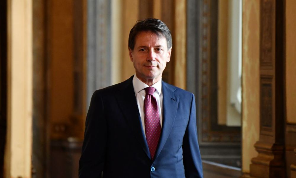 Italian Prime Minister Giuseppe Conte walks during a meeting with NATO General Secretary on June 11, 2018 at Chigi palace in Rome.  Alberto PIZZOLI / AFP