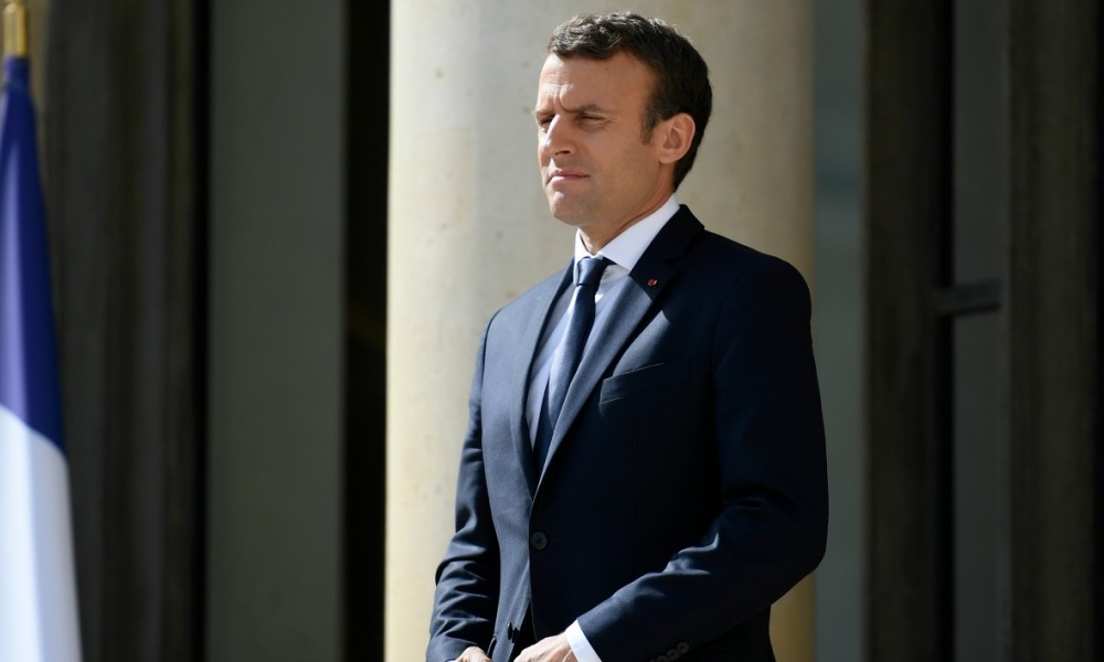 French President Emmanuel Macron watches his Senegalese counterpart leaving following their meeting at the Elysee palace on June 12, 2017 in Paris. French President Emmanuel Macron's party is on course for an overwhelming parliamentary majority, after the June 11, 2017 first round of voting for the National Assembly left traditional parties in disarray. Lionel BONAVENTURE / AFP