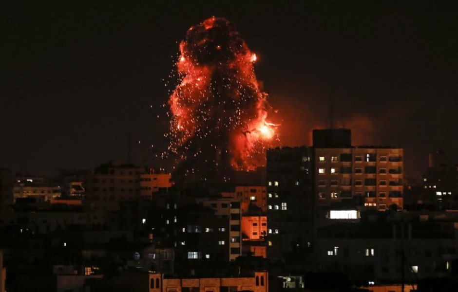 "A picture taken on November 12, 2018, shows a ball of fire above the building housing the Hamas-run television station al-Aqsa TV in the Gaza City during an Israeli air strike. Israel's military said it was carrying out air strikes ""throughout the Gaza Strip"" after rocket fire from the Palestinian enclave towards its territory. Mahmud Hams / AFP"