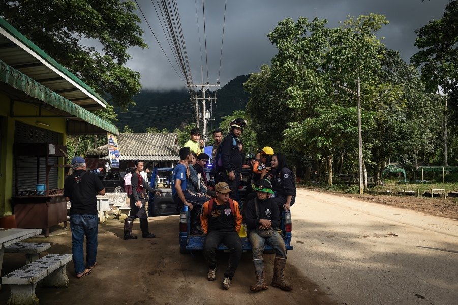 Thai emergency rescue workers on standby near the Tham Luang cave, at the Khun Nam Nang Non Forest Park in Chiang Rai province on July 1, 2018 as the rescue operation continues for a missing children's football team and their coach.