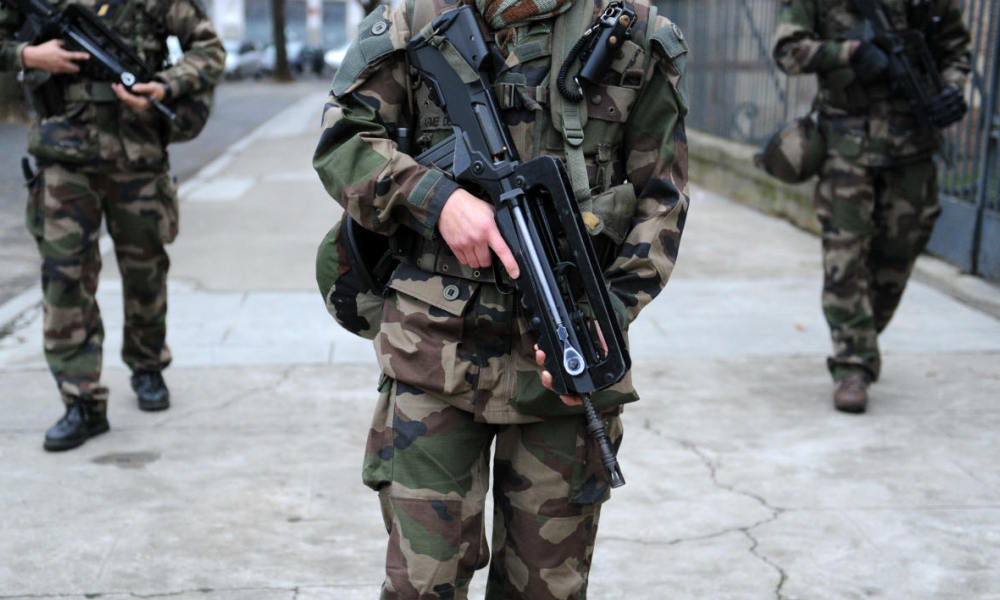 Soldiers patrol as part of the Operation sentinelle, on December 31, 2015 in Toulouse.
