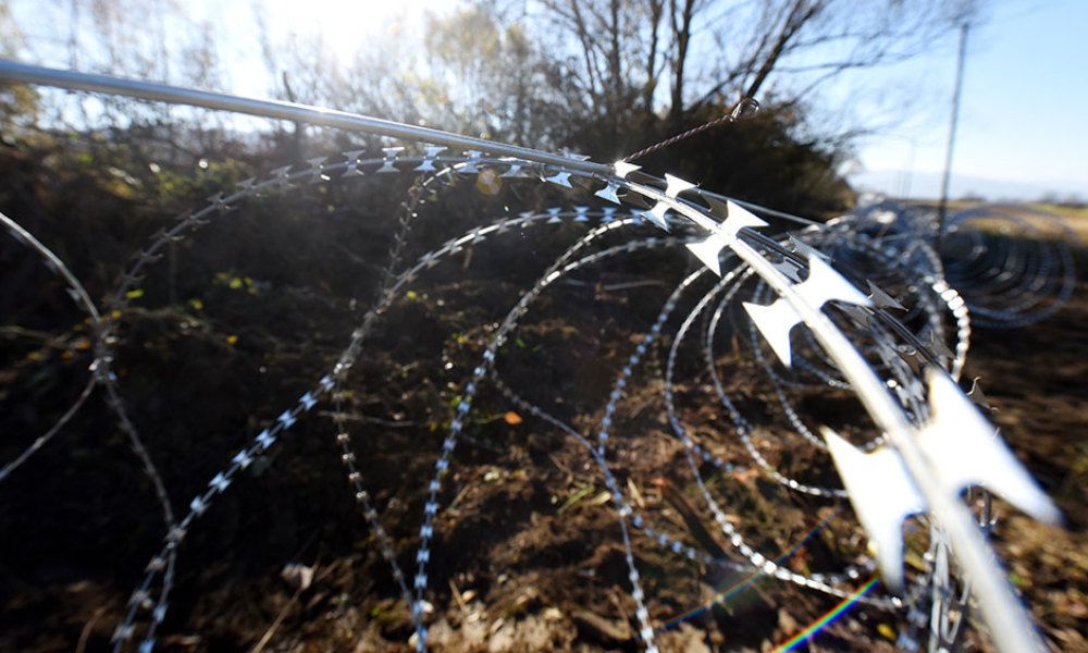 A photo taken on November 12, 2015 shows barbed wire fences set by Slovenian soldiers on the Slovenian-Croatian border near Rakovec. Slovenia found itself on the Balkans route taken by thousands of migrants heading to northern Europe after Hungary sealed its borders with Croatia and Serbia and began erecting razor wire along the border with fellow European Union member Croatia on November 11, in a move the government says will help it better manage a record influx of migrants. More than 180,000 passing have passed through the small EU member state of two million people since mid-October, all but a handful heading for Austria and beyond.