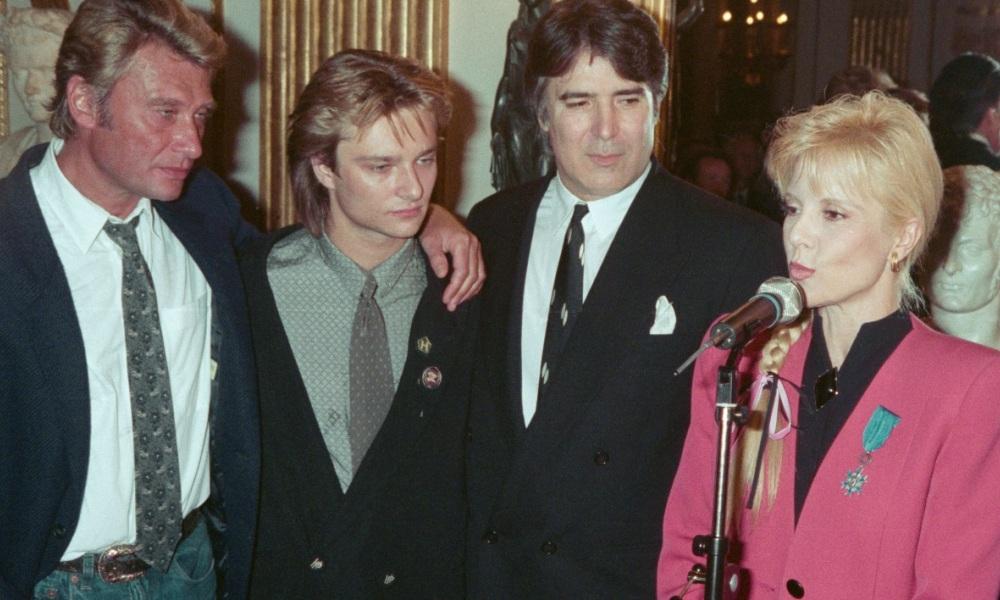 Johnny Hallyday, David Hallyday, Tony Scotti et Sylvie Vartan en 1987