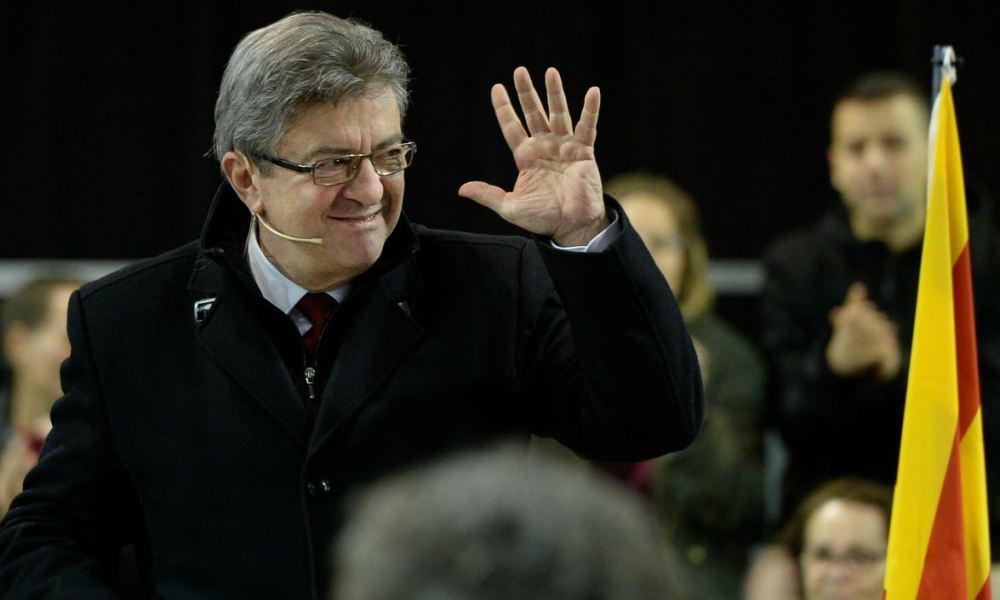 "Leader of French leftist party ""La France insoumise"" Jean-Luc Melenchon waves as he takes part in a campaign meeting of ""Catalunya en comu podem"" (Catalonia in common we can) electoral coalition for the upcoming Catalan regional election in Badalona on December 15, 2017."