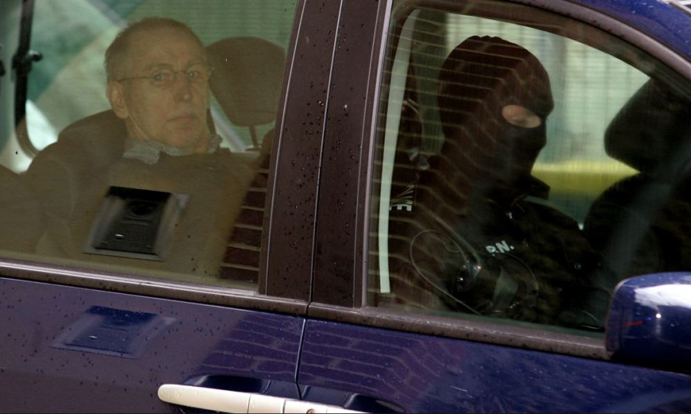 French self-confessed serial killer Michel Fourniret (L) arrives to attend the civil hearings, on May 29, 2008 at the Charleville-Meziere courthouse, northern France.