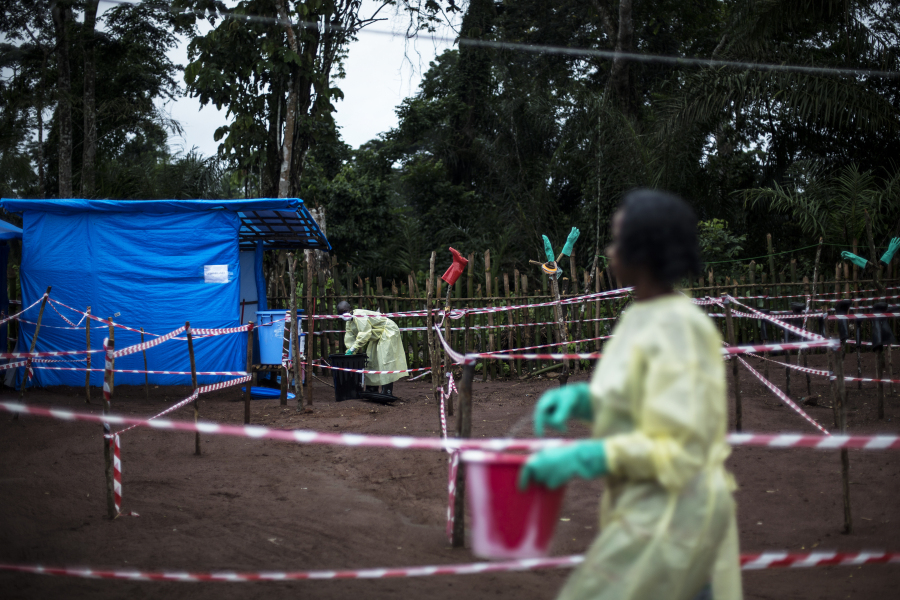 Health workers work at an Ebola quarantine unit on June 13, 2017 in Muma, after a one case of Ebola was confirmed in their village. JOHN WESSELS / AFP