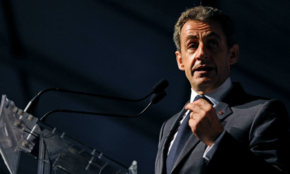 "Former French president and president of French right-wing opposition party Les Republicains, Nicolas Sarkozy, delivers a speech on stage during the third ""Fete de la Violette"" (Violet Festival), a political gathering organised by ""La Droite Forte"" (The Strong Right), a movement of the party, in La Ferte-Imbault, central France, on July 4, 2015. AFP PHOTO / GUILLAUME SOUVANT"