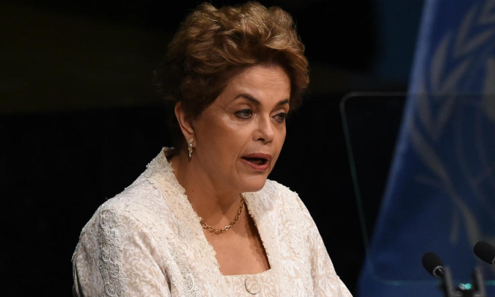 President of Brazil, Dilma Rousseff speaks during the high level signature ceremony for the Paris Agreement at the United Nations General Assembly Hall April 22, 2016 in New York.  TIMOTHY A. CLARY / AFP