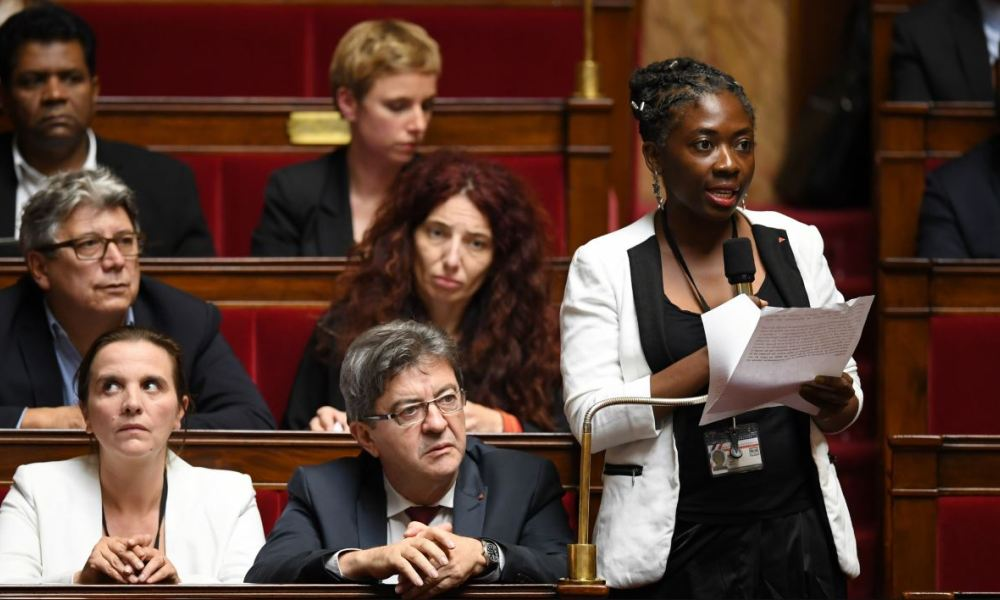 Far left party la France Insoumise (FI) deputy Daniele Obono (R) addresses the government at the National Assembly as FI leader Jean-Luc Melenchon listens during a session of questions to the government on October 24, 2017 in Paris.  Eric FEFERBERG / AFP