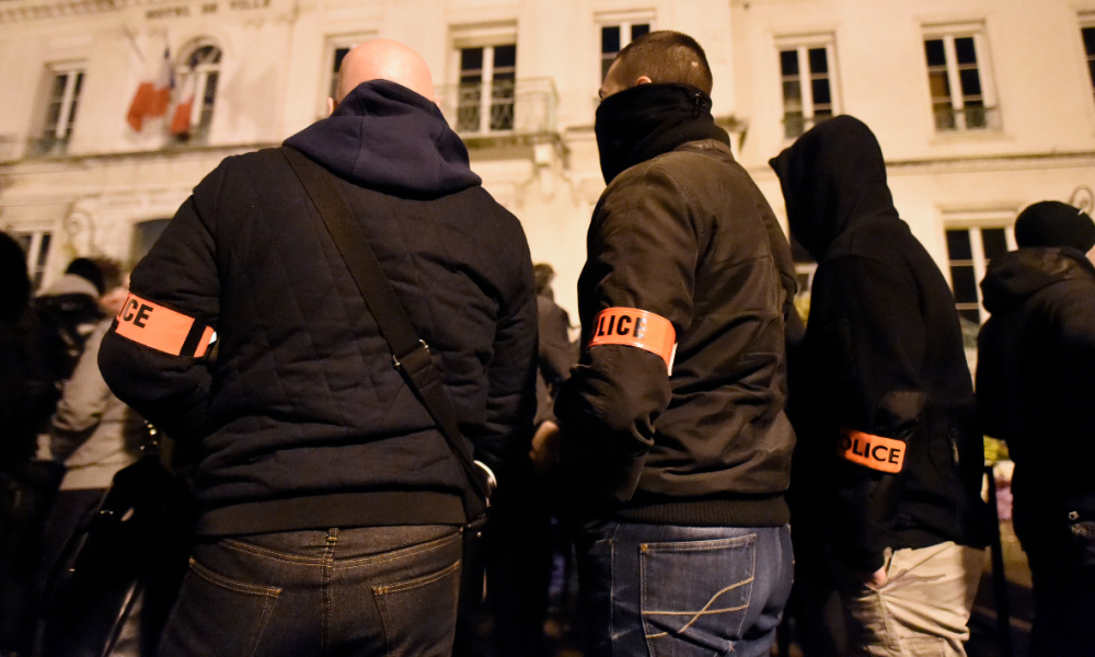 French policemen take part in a gathering in front of the Viry-Châtillon's city hall, to mark one month since an attack on police on November 8, 2016 in Viry-Chatillon, south of Paris. On October 8, 2016, a group of around 15 youths surrounded four policemen and lobbed Molotov cocktails at them, trying to set fire to their patrol vehicle. Police officers are demanding reinforcements and stiffer penalties after a string of attacks on law enforcement, as the issue of safety feeds into France's looming presidential race. MIGUEL MEDINA / AFP