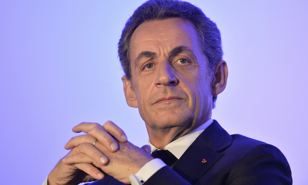 French right-wing Les Republicains (LR) party's president Nicolas Sarkozy looks on during a campaign meeting for the party's top candidate in the upcoming regional elections in the Pays-de-la-Loire region, Bruno Retailleau (not pictured), on November 9, 2015, in Andard, north-western France