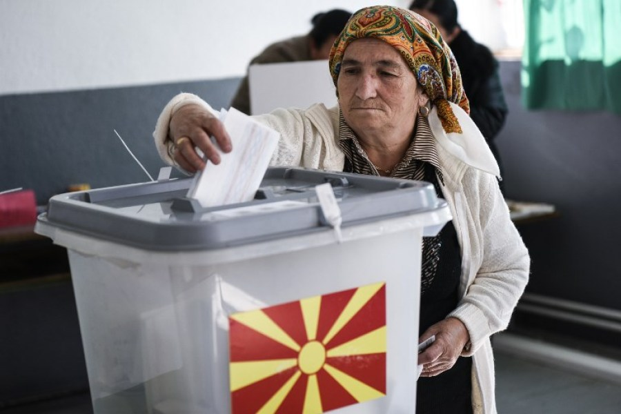 An Albanian woman casts her vote at a polling station in the village of Zajas on September 30, 2018, for a referendum to re-name the country. Macedonians cast ballots on September 30 on whether to re-name their country North Macedonia, a bid to settle a long-running row with Greece and unlock a path to NATO and EU membership. Armend NIMANI / AFP