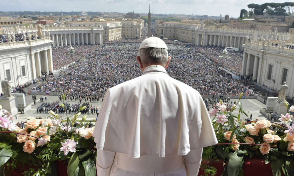 "VATICAN-POPE-EASTER-SUNDAY-MASS  This handout picture released by the Vatican press office shows Pope Francis during the ""Urbi et Orbi"" blessing for Rome and the world from the central loggia of St Peters' basilica following the Easter Sunday mass on April 16, 2017"