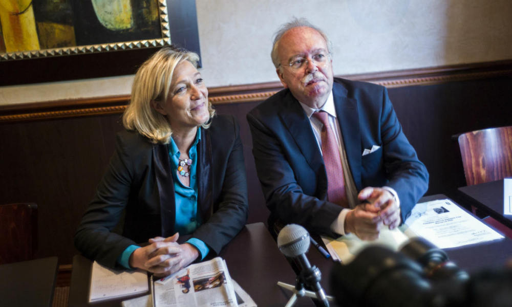 French far right party Front National (FN) president Marine Le Pen (L) and Wallerand de Saint-Just, FN Executive committee member and party's candidate for the 2014 municipal elections in Paris attend a press conference on June 26, 2013 in Paris. AFP PHOTO / FRED DUFOUR