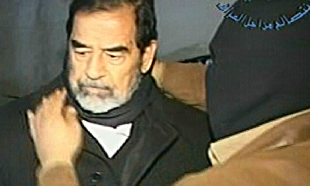 BAGHDAD, IRAQ - DECEMBER 30: In this television screen grab taken from Iraqi national television station Al-iraqia, a video shows the moments leading up to the execution of former Iraqi dictator Saddam Hussein as he is prepared for hanging, on December 30, 2006 in Baghdad, Iraq. The former Iraqi president was executed by hanging at 0600 (0300 GMT) in a secure facility in the Northern Baghdad suburb of Khadimeya. (Photo by Al-iraqia via Getty Images) *** Local Caption *** Saddam Hussein Handout / GETTY IMAGES EUROPE / Getty Images/AFP