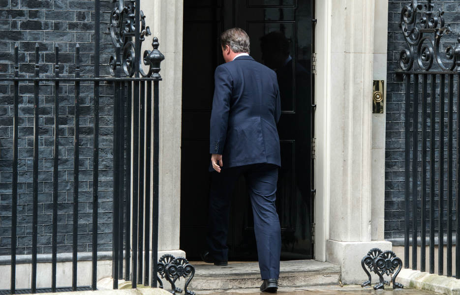 British Prime Minister David Cameron walks back into 10 Downing Street in London on July 11, 2016, after announcing to the media that Theresa May would be Britain's new leader. Theresa May will become Britain's new leader on Wednesday, Prime Minister David Cameron said on Monday after her sole rival pulled out of a leadership race.
