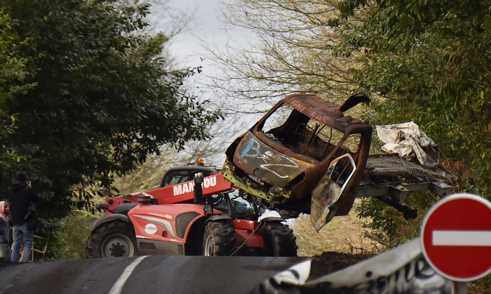 "A truck carries the wreckage of a car as it clears the blocked departmental road D281 crossing the ""Zad"" (""zone a defendre"", zone to defend) of Notre-Dame-des-Landes, on January 22, 2018 a few days after the French government's official decision to abandon the Grand Ouest Airport (AGO) project in Notre-Dame-des-Landes."
