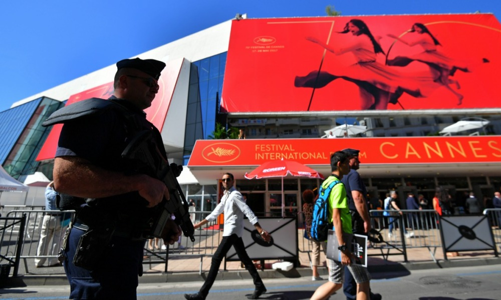 A police officer patrols in front of the Palais des Festivals along the top end of The Croisette on May 17, 2017 in Cannes, before the opening of the 70th Cannes Film Festival.  LOIC VENANCE / AFP