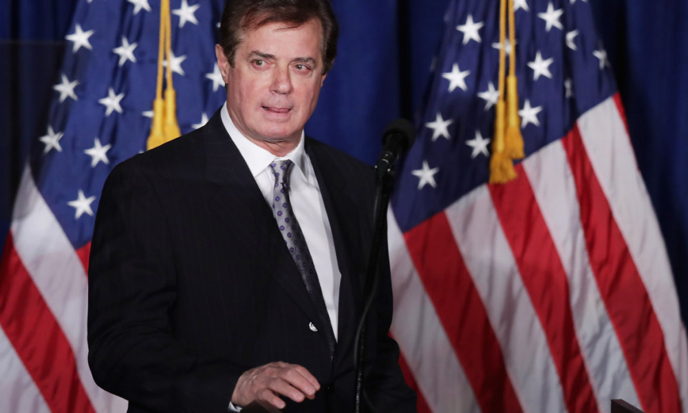 "(FILES) This file photo taken on April 27, 2016 shows Paul Manafort, advisor to Republican presidential candidate Donald Trump's campaign, checking the teleprompters before Trump's speech at the Mayflower Hotel in Washington, DC Corruption investigators in Ukraine say an illegal, off-the-books payment network earmarked $12.7 million in cash payments for Donald Trump's presidential campaign chairman Paul Manafort, the New York Times reported August 15, 2016. Manafort issued a statement vehemently denying any wrongdoing. ""The suggestion that I accepted cash payments is unfounded, non-sensical and silly,"" the statement says, according to NBC News.  CHIP SOMODEVILLA / GETTY IMAGES NORTH AMERICA / AFP"