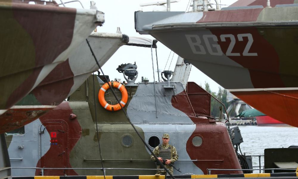 Ukrainian frontier stands aboard a patrol boat at the commercial port of Mariupol on the Sea of Azov on August 14, 2018. The small sea is located in a zone of heightened tensions between Russia and Ukraine.