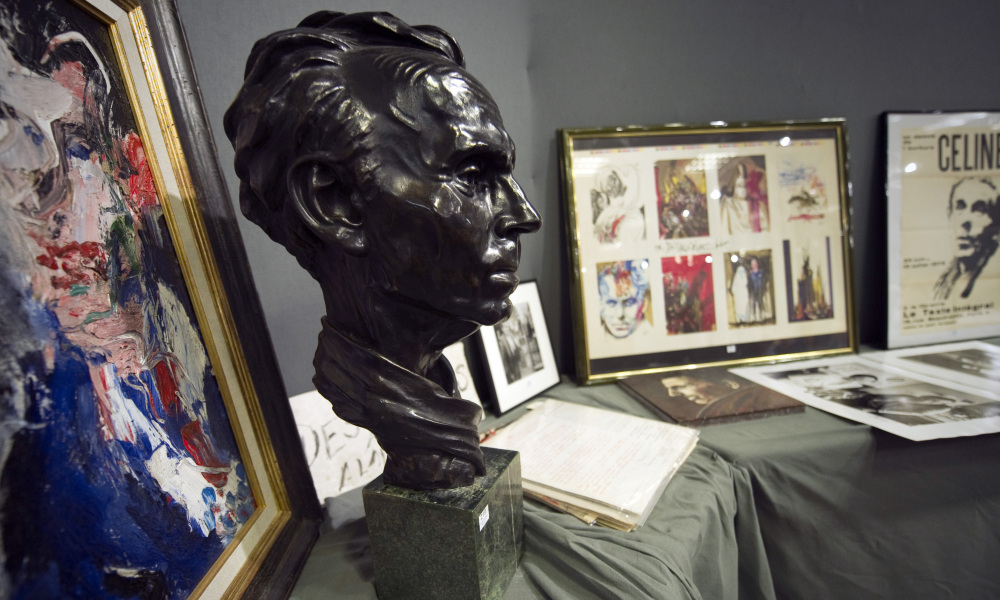 A picture taken on June 17, 2011 at Paris Drouot auction house, shows paintings, posters, pictures and of a bust of French novelist Louis-Ferdinand Celine, during an auction marking the 50th anniversary of the writer's death.