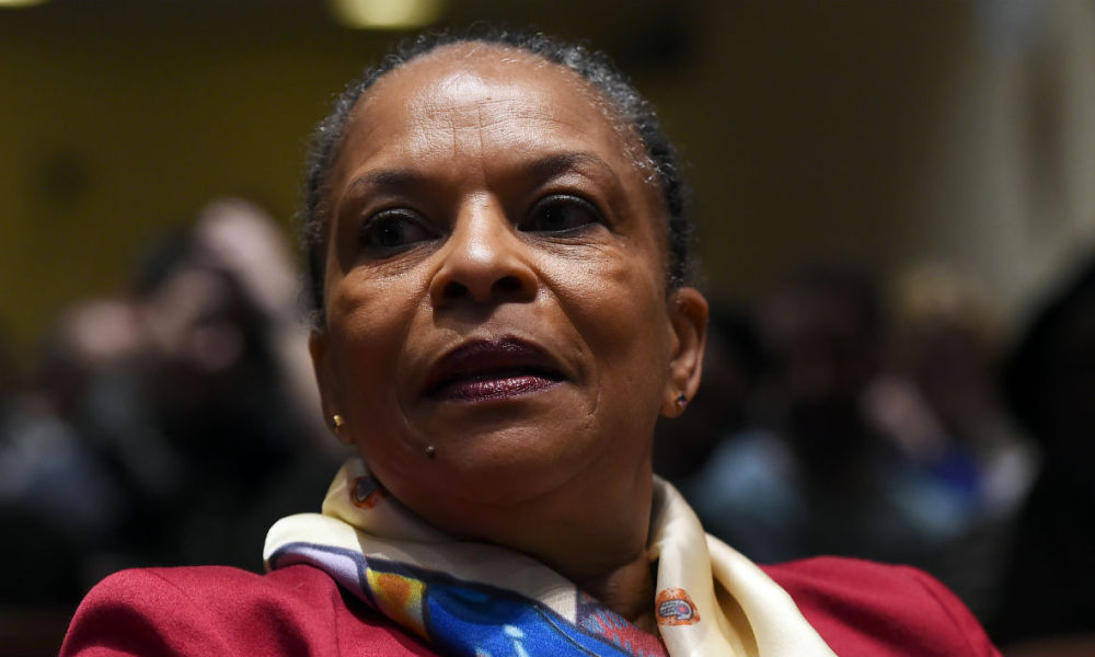 French Justice Minister Christiane Taubira arrives to speak at a campus of the New York University on January 29, 2016, in New York Taubira quit in protest over the government's efforts to strip convicted French-born terrorists of their citizenship if they have a second nationality.