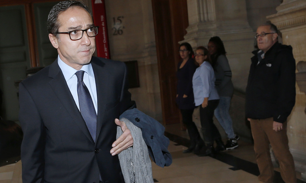 former chief of staff of current French president, Faouzi Lamdaoui arrives on October 5, 2015 at Paris' Court house to attend his trial on charge of abuse of social goods in a case dating back to 2007-2008