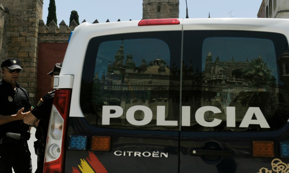 A picture taken on July 8, 2016 shows the reflection of the Cathedral of Seville in a the windows of a van of the Spanish National Police patrolling outside the Alcazar of Seville, in Sevilla, on the eve of the official visit of US President Barack Obama to Spain.