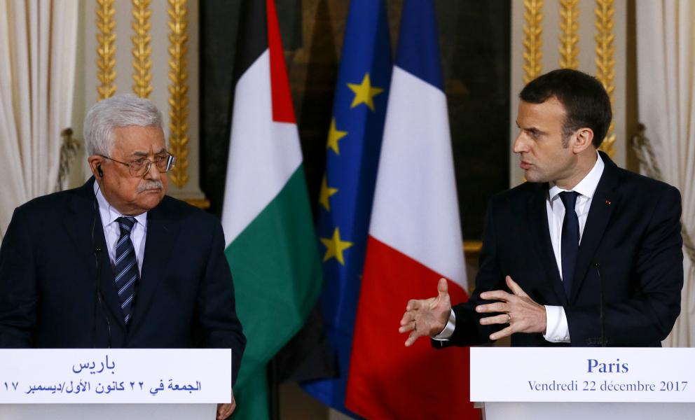 French president Emmanuel Macron (R) and Palestinian President Mahmud Abbas give a joint press conference following their meeting at the Elysee presidential Palace, in Paris, on December 22, 2017. Abbas visits France in the hopes that France takes a leading role in opposing the US recognition of Jerusalem as Israel's capital. Francois Mori / POOL / AFP