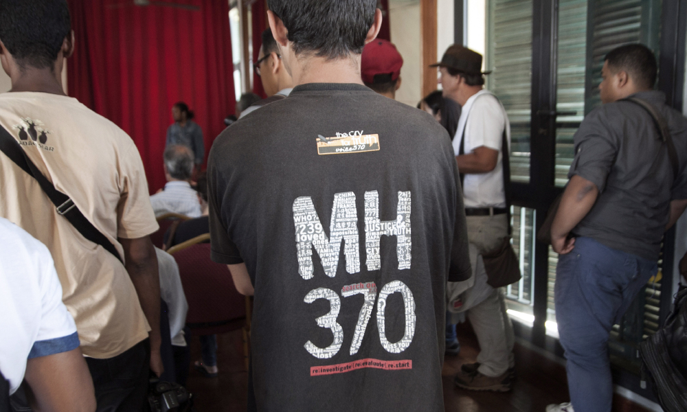 People attend a press conference organised by an organisation representing the relatives of missing MH370 passengers, on December 5, 2016 in Antananarivo.
