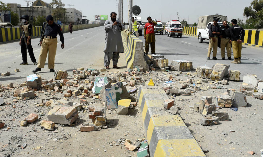 Pakistani security officials inspect the site of a roadside bomb blast in Quetta on August 11, 2016. A roadside bomb apparently targeting a judge injured at least 13 people in Pakistan's southwestern city of Quetta on August 11, officials said, days after a major attack killed most of the city's senior lawyers.