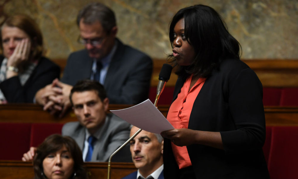French MP Laetitia Avia of the La Republique En Marche (REM) party asks a question during a session of questions to the government at the National Assembly in Paris on November 8, 2017.  CHRISTOPHE ARCHAMBAULT / AFP