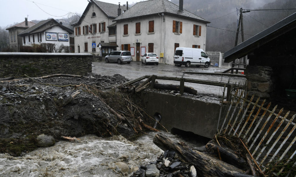 The damaged bank of a river after it overflowed and flooded the area during Storm Eleanor is pictured on January 4, 2018, in the village of Moretel-de-Mailles, near Crets-en-Belledonne, Auvergne-Rhone-Alpes region, south-eastern France. Eleanor, the fourth winter storm to hit Europe since December, swept into the continent on January 3, 2018 after battering Britain and Ireland.  PHILIPPE DESMAZES / AFP