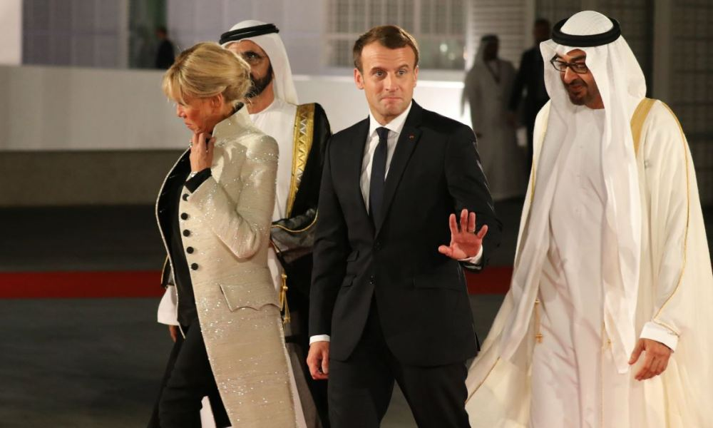 Ruler of Dubai Sheikh Mohammed bin Rashid al-Maktoum (C-Back) and Abu Dhabi Crown Prince Mohammed bin Zayed Al-Nahyan (R) greet French President Emmanuel Macron and his wife Brigitte Macron at the entrance of the Louvre Abu Dhabi Museum on November 8, 2017 during its inauguration on Saadiyat island in the Emirati capital.  LUDOVIC MARIN / AFP